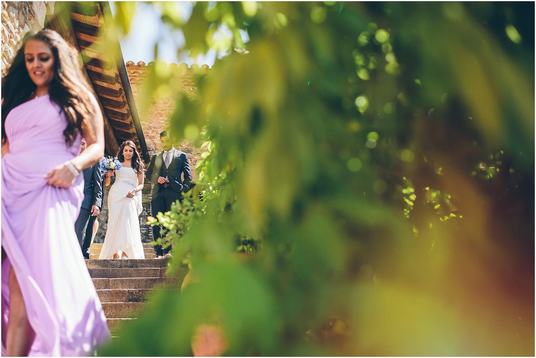 bride making her way to ceremony at castell d'emporda