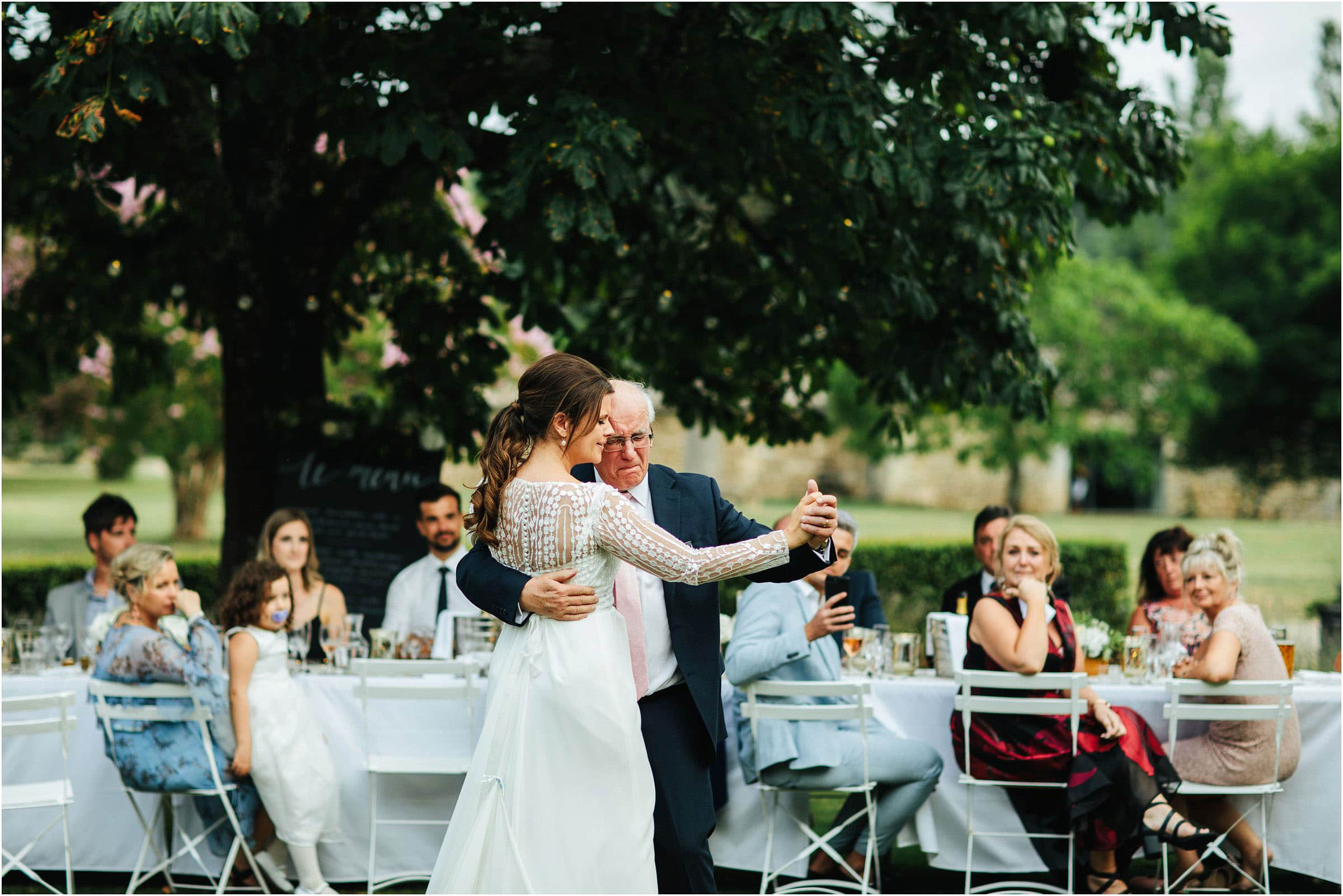 bride and father of the bride dancing outside in the gardens of chateau rigaud